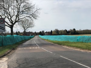 A hedge covered with netting in Alveston near Stratford-upon-Avon.