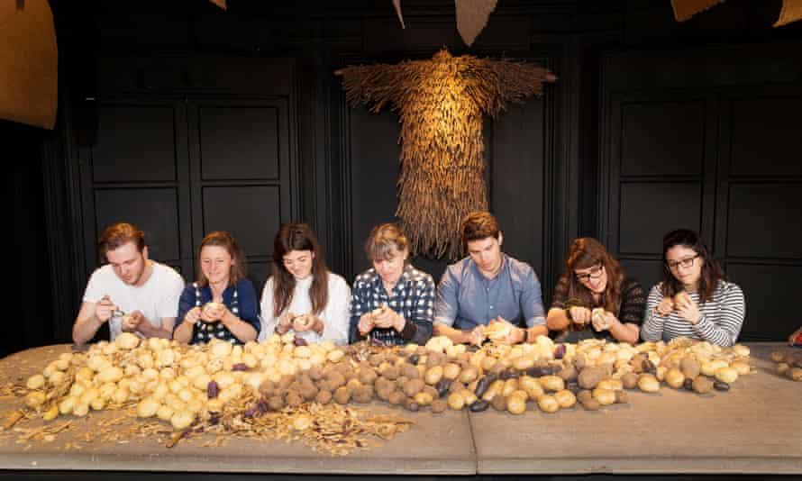 People peel potatoes