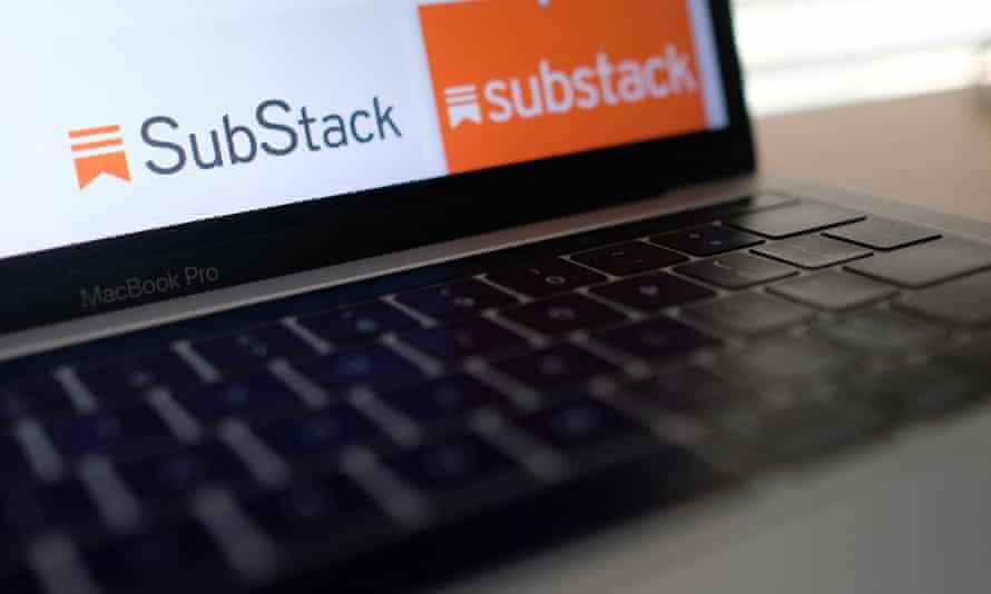 A laptop screen displays the Substack logo
