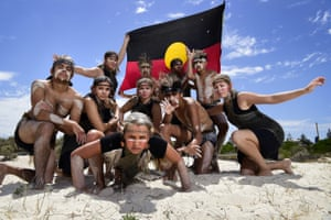 Old Wisdom New Ways traditional dancers pose for a photograph during a survival day event at Semaphore Beach in Adelaide