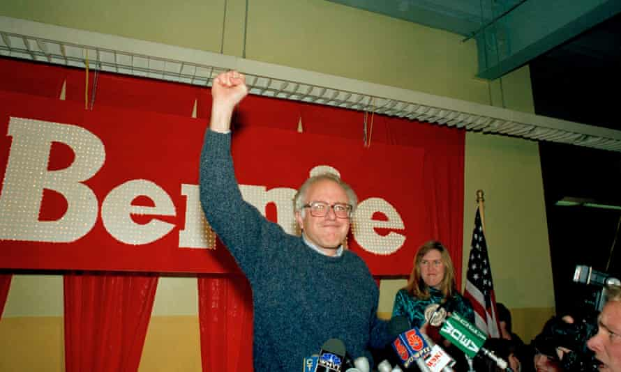 Bernard Sanders raises his arms