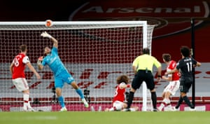 Martinez saves a shot from Salah.