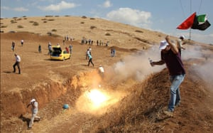 Palestinian demonstrators clash with Israeli security forces following a protest against the expropriation of Palestinian land in the village of Tamun in the Israeli-occupied West Bank.