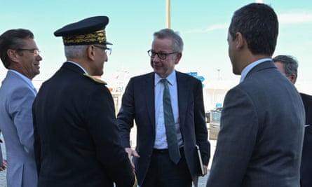 Michael Gove (centre) viewed the rehearsal with the French minister of public action and accounts Gerald Darmanin (right)