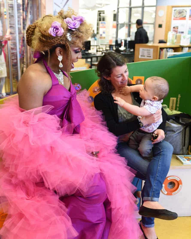 Honey Mahogany with one-year-old Oscar Morales and his mom Sarah Morales.