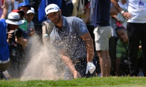 Dustin Johnson plays his third shot from a bunker on the second hole.