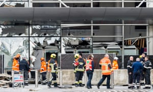 Emergency workers outside a damaged building at Zaventem airport in Brussels, Belgium