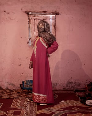 Umm Yasser, the first female Bedouin guide from the Hamada tribe, poses for a photograph in her home in Wadi Sahw, Abu Zenima, Egypt