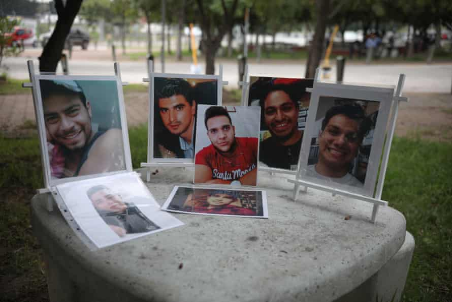 Portraits of missing people are displayed over a table outside the Forensic Medical Service in Guadalajara, Jalisco.