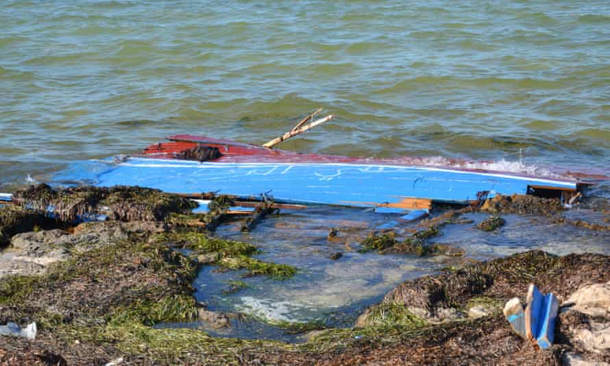 Remains of a boat, from a previous incident, carrying migrants from Libya that sank off south-east Tunisia.