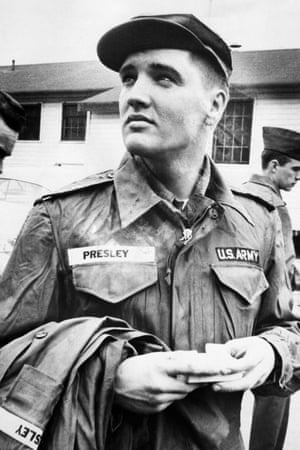 26 March 1958, Fort Chaffee, Arkansas: Private Presley contemplates his next two years of army service while awaiting issue of more clothing. Presley was sent to Fort Hood, Texas, for eight weeks of basic training with the tough Second Armored Division