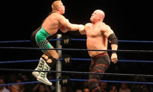 Glenn Jacobs, right, was known for moves such as the Chokeslam and Backbreaker during his time as Kane