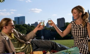 Young couple toasting with wineglasses in a park, Central Park