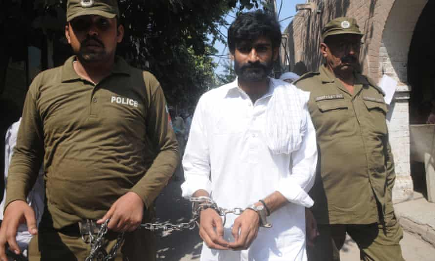 Mohammed Wasim Azeem, Baloch's brother, is escorted by police to court.
