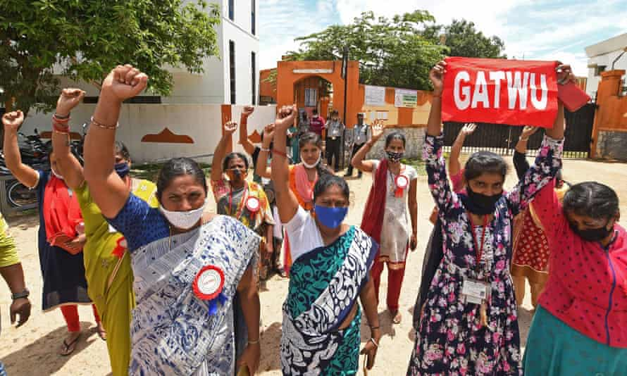 Members of a garment worker union protest in front of their factory, closed due to brands cancelling their orders during the pandemic.