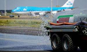 Water is sprayed on a taxiway at Schiphol airport in Amsterdam, the Netherlands