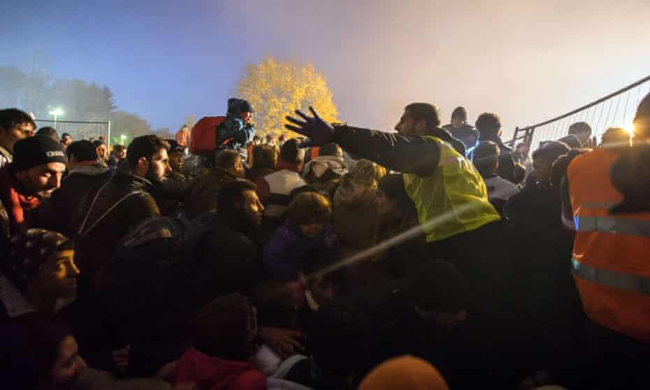 Refugees wait to cross the Slovenian-Austrian border.