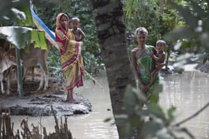 Stranded flood victims wait for help in Pokoria village, north eastern Assam state, India