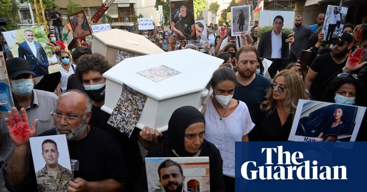 Beirut police fire teargas at protest by relatives of blast victims