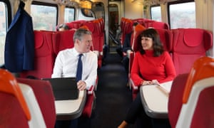 Sir Keir Starmer speaking to shadow chancellor Rachel Reeves when they were on the train to Sheffield earlier to visit a steel plant.