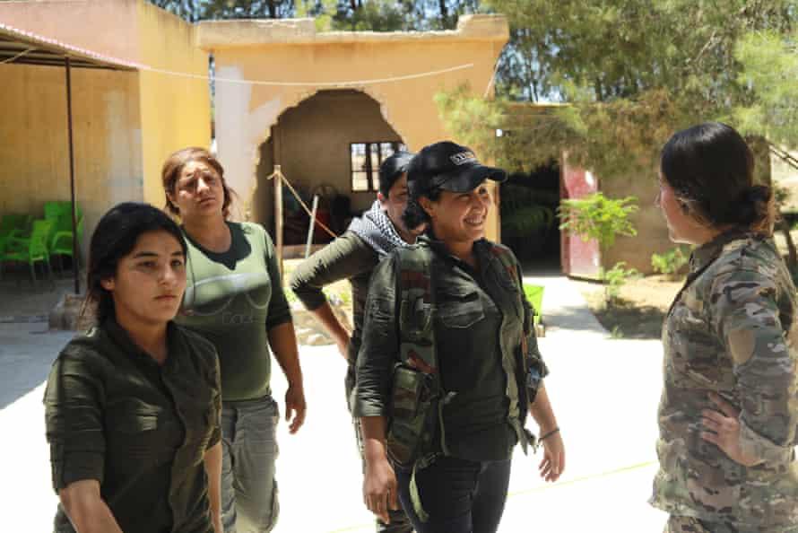 Zeynab Serekaniye prepares to go on duty at Tal Tamr