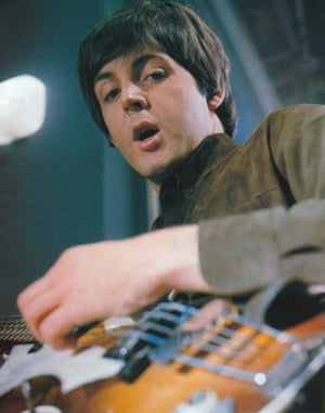 Paul McCartney, seen from the angle of his violin-shaped bass guitar