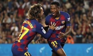 Barcelona's Ansu Fati, right, celebrates with his teammate Antoine Griezmann after opening the scoring against Valencia with his first goal at Camp Nou.