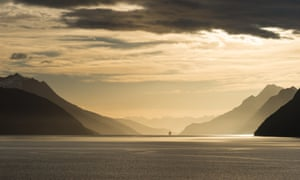 Sunrise in Beagle Channel with Tierra del Fuego Mountains in the background.