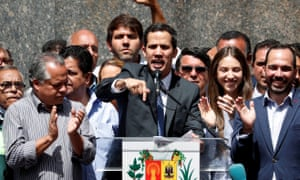 Juan Guaidó speaks during a news conference in Caracas, Venezuela, Friday.