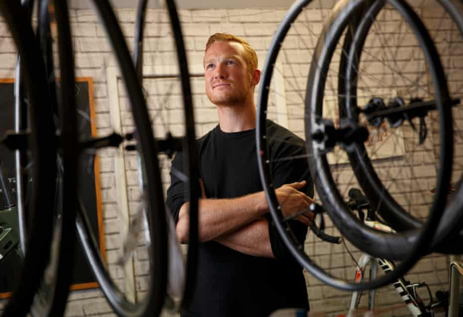 Rutherford poses for a portrait at his local bike shop.