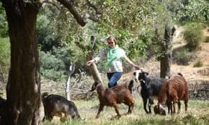 A woman herding goats in Jordan.