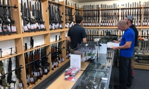 Firearms and accessories are seen on display at Gun City gunshop in Christchurch.