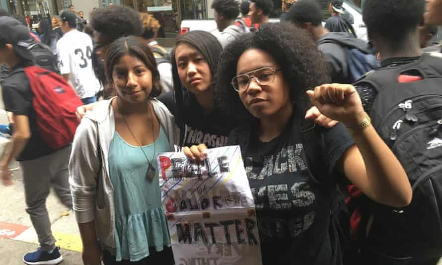 Brittany Robinson (right) and her friends protest in San Francisco.