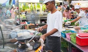 A cook at the night market in Hua Hin, Thailand.