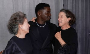 Best supporting actress Youn Yuh-Jung, left, best supporting actor Daniel Kaluuya and best actress Frances McDormand huddle in the Oscars' press room.