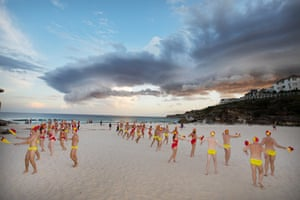 Dancing in soft sand – the members of the surf life savers float practice their moves.