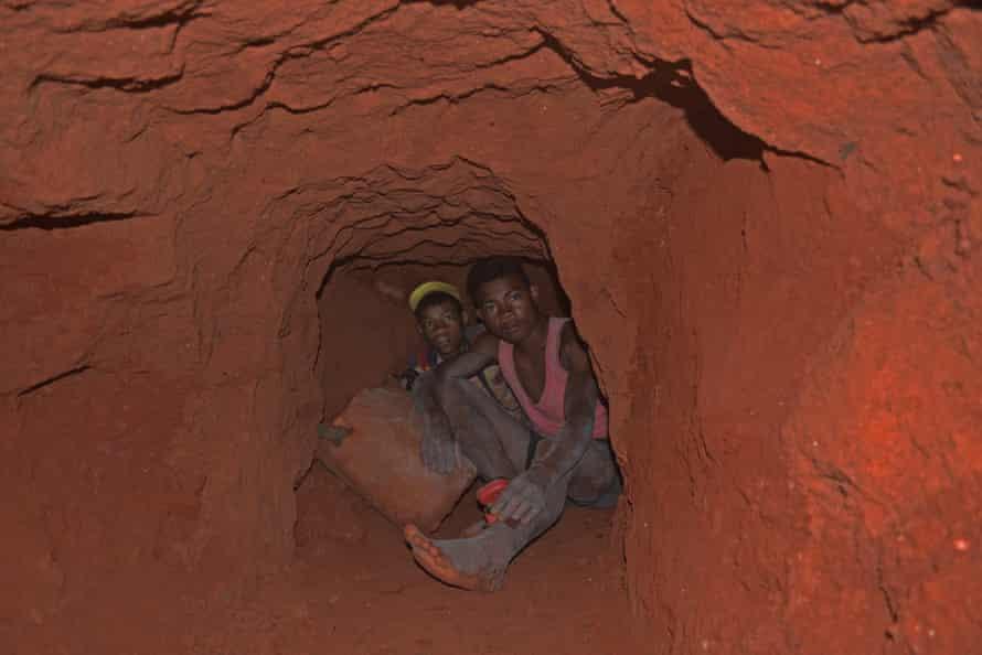 Tavita (left), 14, and Roland, 17, hunting for tourmaline around 15-20 metres below ground.