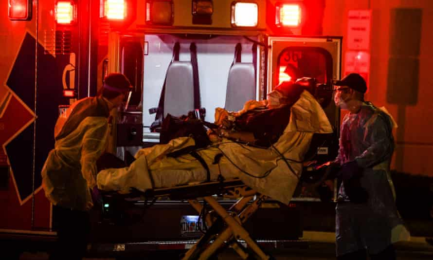 Medics transfer a ship passenger on a stretcher from an ambulance to Broward Health Medical Center in Fort Lauderdale on Thursday night.