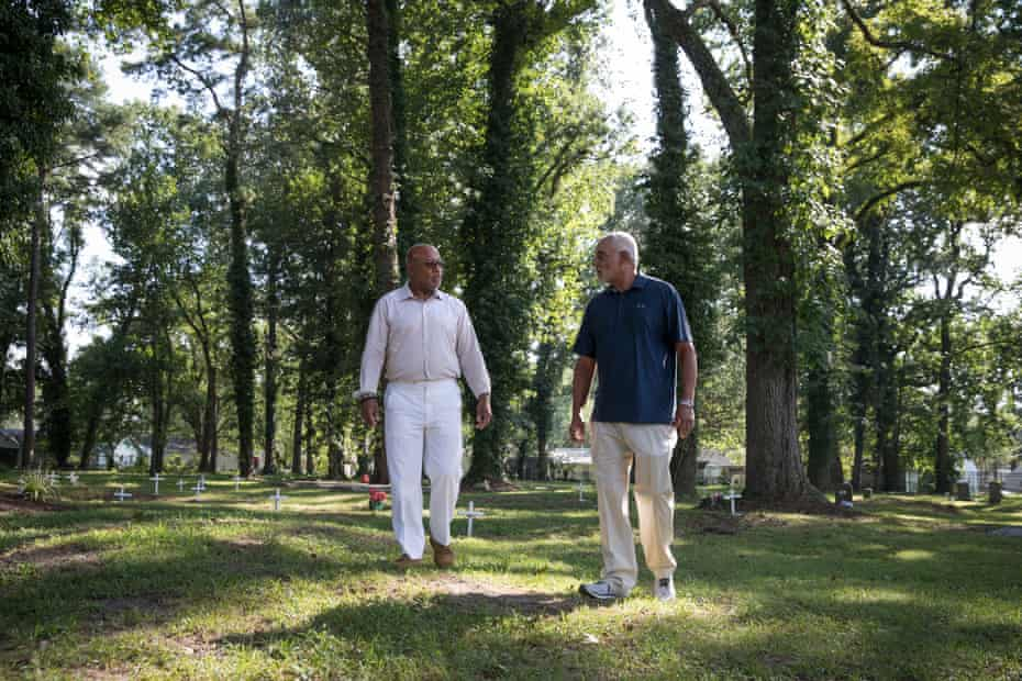 Walter Jones (right) and his first cousin Verrandall Tucker in the Tucker family cemetery in Hampton, Virginia, a two-acre site in the Aberdeen Gardens neighborhood.