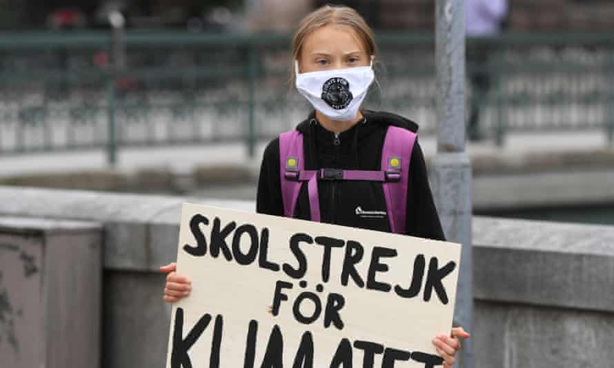 """Greta Thunberg with a placard reading """"School strike for Climate"""" in front of the Swedish parliament on Friday."""