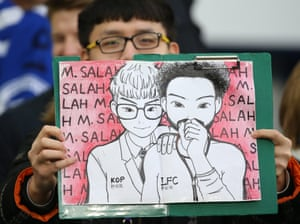 A young Liverpool fan in the crowd shows off his Mohamed Salah drawing prior to the match against Brighton at the Amex Stadium.