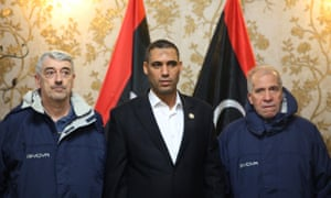 Gino Pollicardo, left, and Filippo Calcagno, right, with a government official