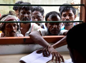 Indian villagers check their names on the final register of citizens at the NRC office in Morigaon, Assam, on 31 August 2019.