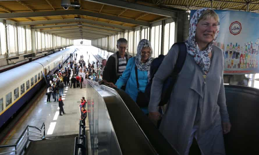 Tourists at Tehran rail station, after arriving in the Iranian capital on a luxury train from Budapest.