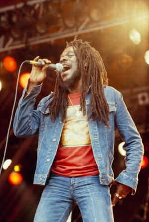 Dennis Brown in an early iteration of double denim, on stage in 1983.