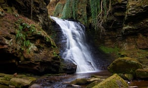 landscape view of stunning waterfall at Hareshaw lynn burn Bellingham Northumberland
