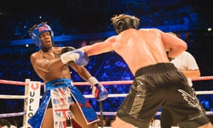 'Fans just want to see YouTubers — and want to see them do anything' … Logan Paul takes a swing at KSI during their Manchester Arena fight on 25 August.