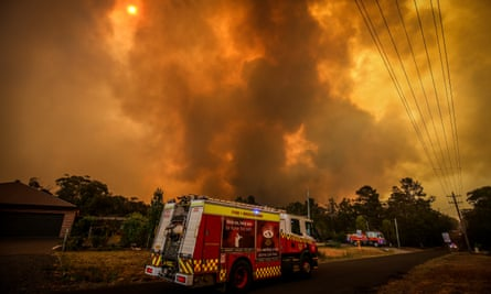 Firefighters battle bushfires on the outskirts of Bargo, south-west of Sydney