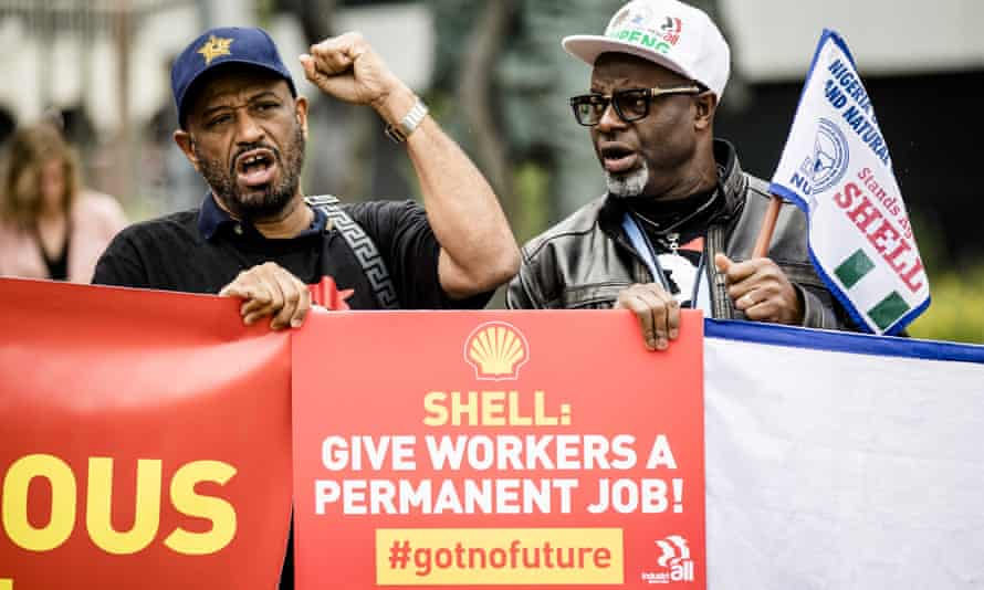 Shell workers protest outside its AGM about employment rights at the oil firm.