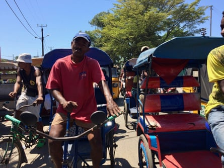 François Bia, a former dockworker, now makes about $2 a day as a rickshaw driver